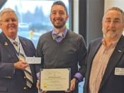 VANCOUVER: Jeff Lightburn, left, and Tom Boardman, right, of the Fort Vancouver Sons of the American Revolution Chapter, present John Zingale his SAR History Teacher of the Year Certificate and $200 check.