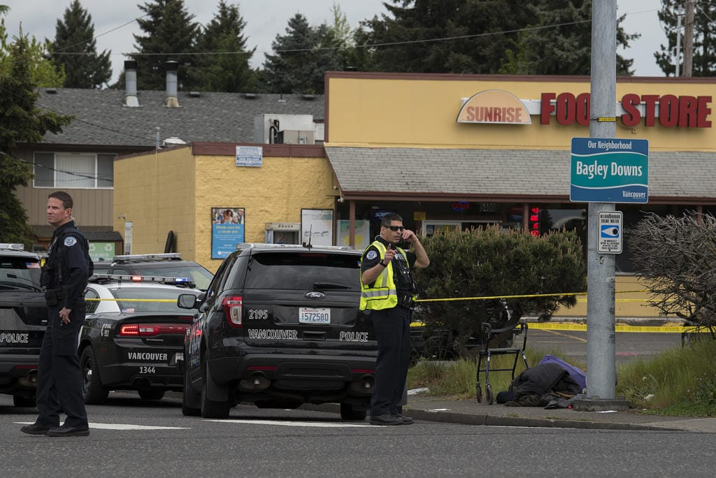 Police investigate the scene of a reported officer-involved shooting at the intersection of Fourth Plain Boulevard and Stapleton Road on Tuesday afternoon, April 28, 2020.
