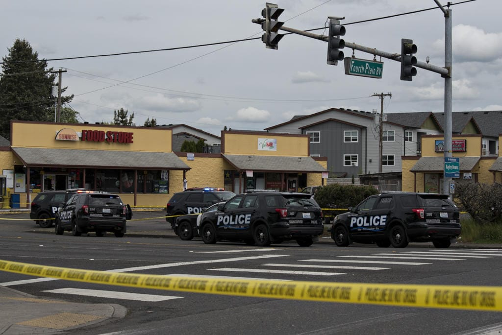 Police work at the scene of a reported officer-involved shooting at the intersection of Fourth Plain Boulevard and Stapleton Road on Tuesday afternoon, April 28, 2020.