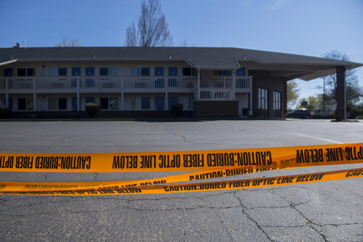 Caution tape surrounds one side of the Motel 6 at 221 N.E. Chkalov Drive in Vancouver.