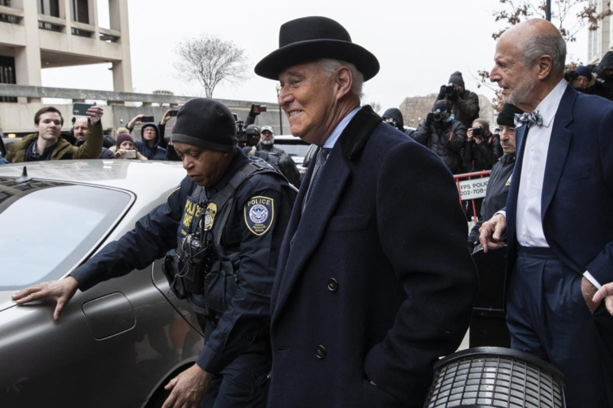Roger Stone, center, departs federal court in Washington, Thursday, Feb. 20, 2020. President Donald Trump loyalist and ally, Roger Stone was sentenced to over three years in federal prison, following an extraordinary move by Attorney General William Barr to back off his Justice Department's original sentencing recommendation. The sentence came amid President Donald Trump's unrelenting defense of his longtime confidant that led to a mini-revolt inside the Justice Department and allegations the president interfered in the case.