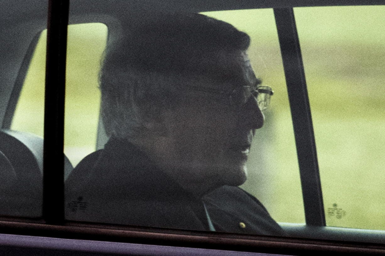 Cardinal George Pell sits in the back seat of a car as he leaves prison in Geelong, Australia Tuesday, April 7, 2020. Pope Francis' former finance minister Pell had been the most senior Catholic found guilty of sexually abusing children and has spent 13 months in high-security prisons before seven High Court judges unanimously dismissed his convictions.