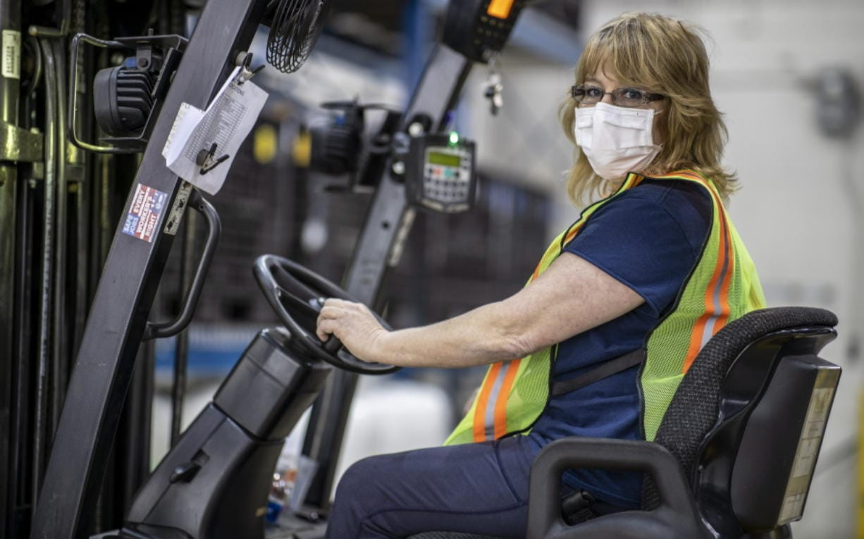 This photo provided by Cindy Parkhurst. shows Cindy Parkhurst working at the Ford Flat Rock Assembly Plant in Flat Rock, Mich.