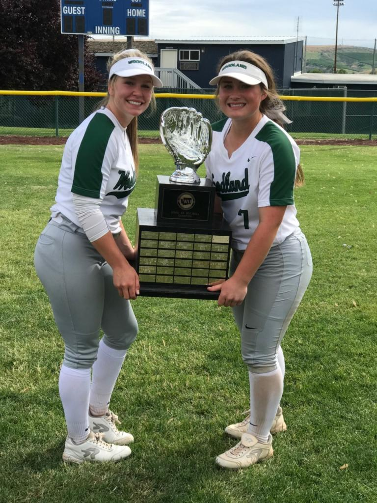 Kelly Sweyer (left) and Kaily Christensen hold the state championship trophy they won as part of the Woodland High School softball team (Photo courtesy of Woodland High School)