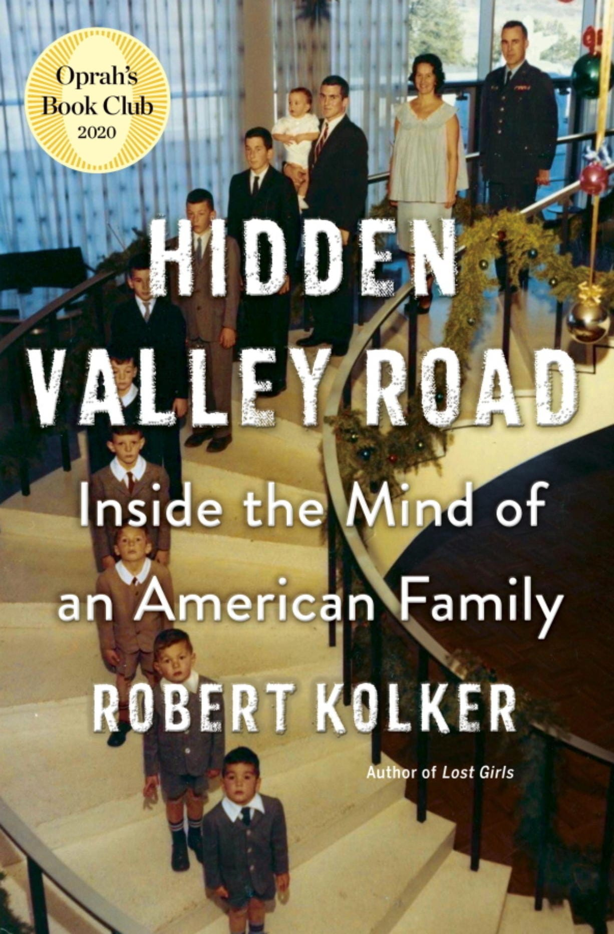 """This cover image released by Doubeday shows Robert Kolker's """"Hidden Valley Road."""" The book, an in-depth and highly praised account of a 1950s family in which six children were diagnosed with schizophrenia, was selected by Oprah Winfrey for her book club. Winfrey says that she will continue picking books during the coronavirus outbreak, and will seek new ways to engage readers."""