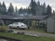 Fire District 5 crews battle a house fire in the Sifton area on Monday morning.