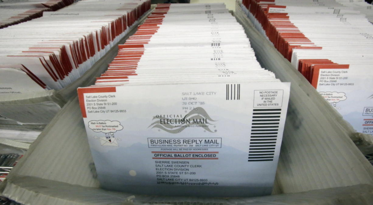 FILE - In this Nov. 1, 2016, file photo, mail-in ballots for the 2016 General Election are shown at the elections ballot center at the Salt Lake County Government Center, in Salt Lake City. As President Donald Trump rails against voting by mail, many members of his own political party are embracing it to keep their voters safe during the coronavirus outbreak.