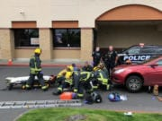 Vancouver Fire Department crews were dispatched Wednesday to a shopping center parking lot at 5000 E. Fourth Plain Blvd., after a car struck a man, pinning him underneath. Vancouver police later said the man, who was skateboarding, was intentionally run over and died of his injuries. The driver, identified by police as Joshua L. Jones, was arrested on suspicion of second-degree murder.