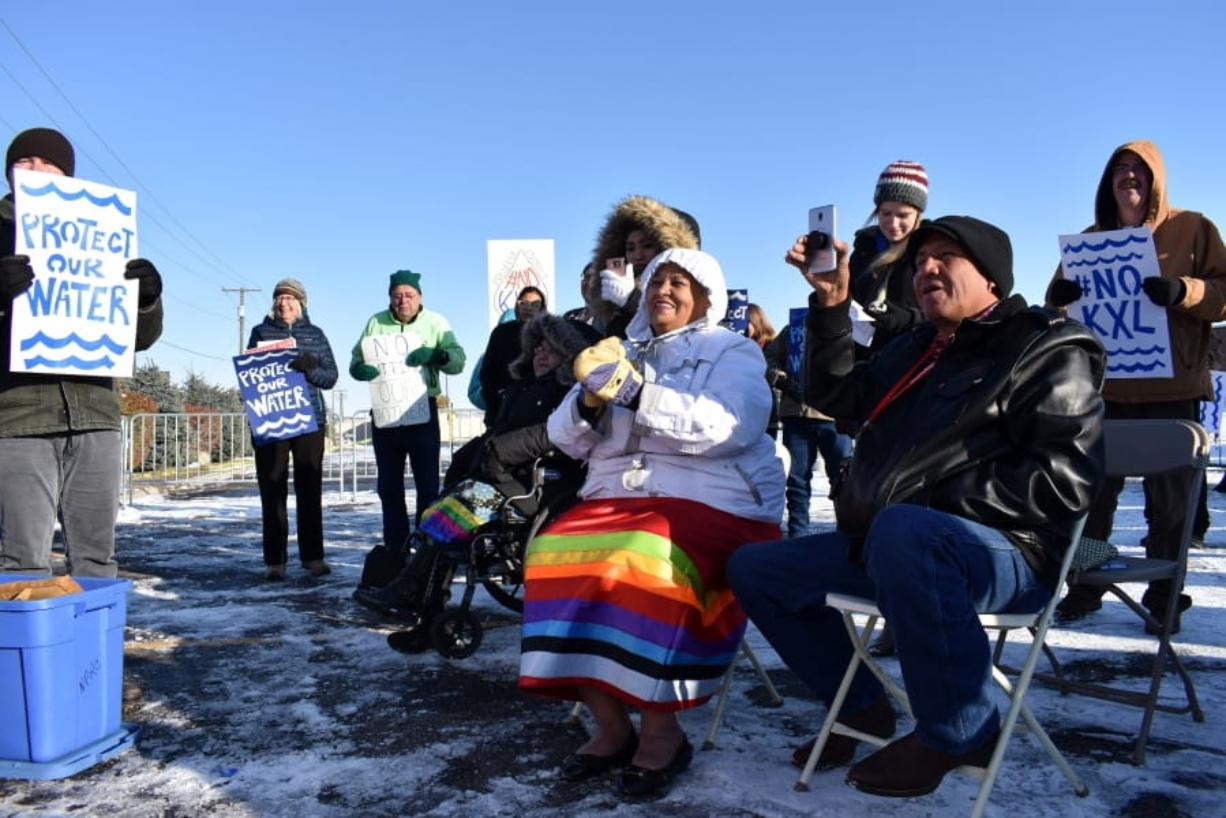 FILE - In this Oct. 29, 2019 file photo, opponents of the Keystone XL oil pipeline from Canada demonstrate in sub-freezing temperatures in Billings, Mont. Alberta is investing $1.1 billion in the disputed Keystone XL pipeline, a project that Alberta Premier Jason Kenney says is crucial for the province's economy.