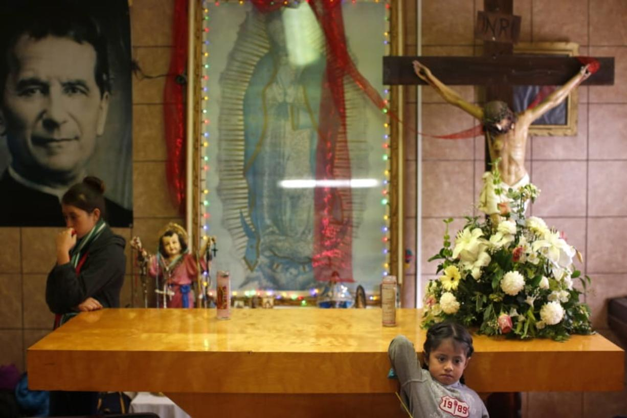 Migrants rest Feb. 26 in the chapel of the San Juan Bosco migrant shelter, in Nogales, Mexico. For years, Catholic-led, United States-based nonprofits have been at the forefront of efforts to support migrants and asylum-seekers along the Mexican border. Tough new border policies, coupled with the COVID-19 pandemic, have drastically changed their work, much of which now takes place in Mexico.