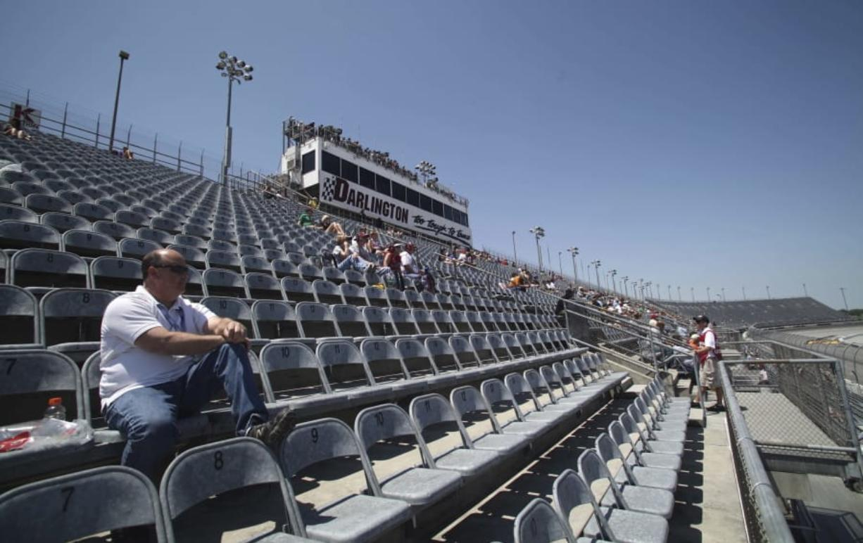 A few fans are shown in the grandstands to watch NASCAR practice in 2012 at Darlington Raceway in Darlington, S.C. NASCAR will get its season back on track starting May 17 at Darlington Raceway without spectators.