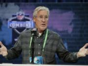 Seattle Seahawks head coach Pete Carroll speaks during a press conference at the NFL football scouting combine in Indianapolis. The NFL Draft is April 23-25.