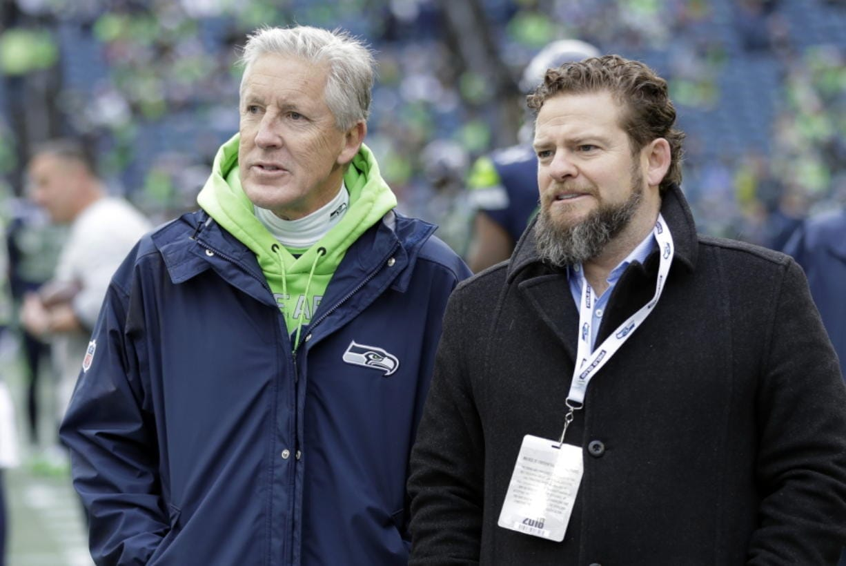 Seattle Seahawks coach Pete Carroll, left, and general manager John Schneider pictured here in 2018, are always good for a few surprises in the NFL draft. (AP Photo/Ted S.