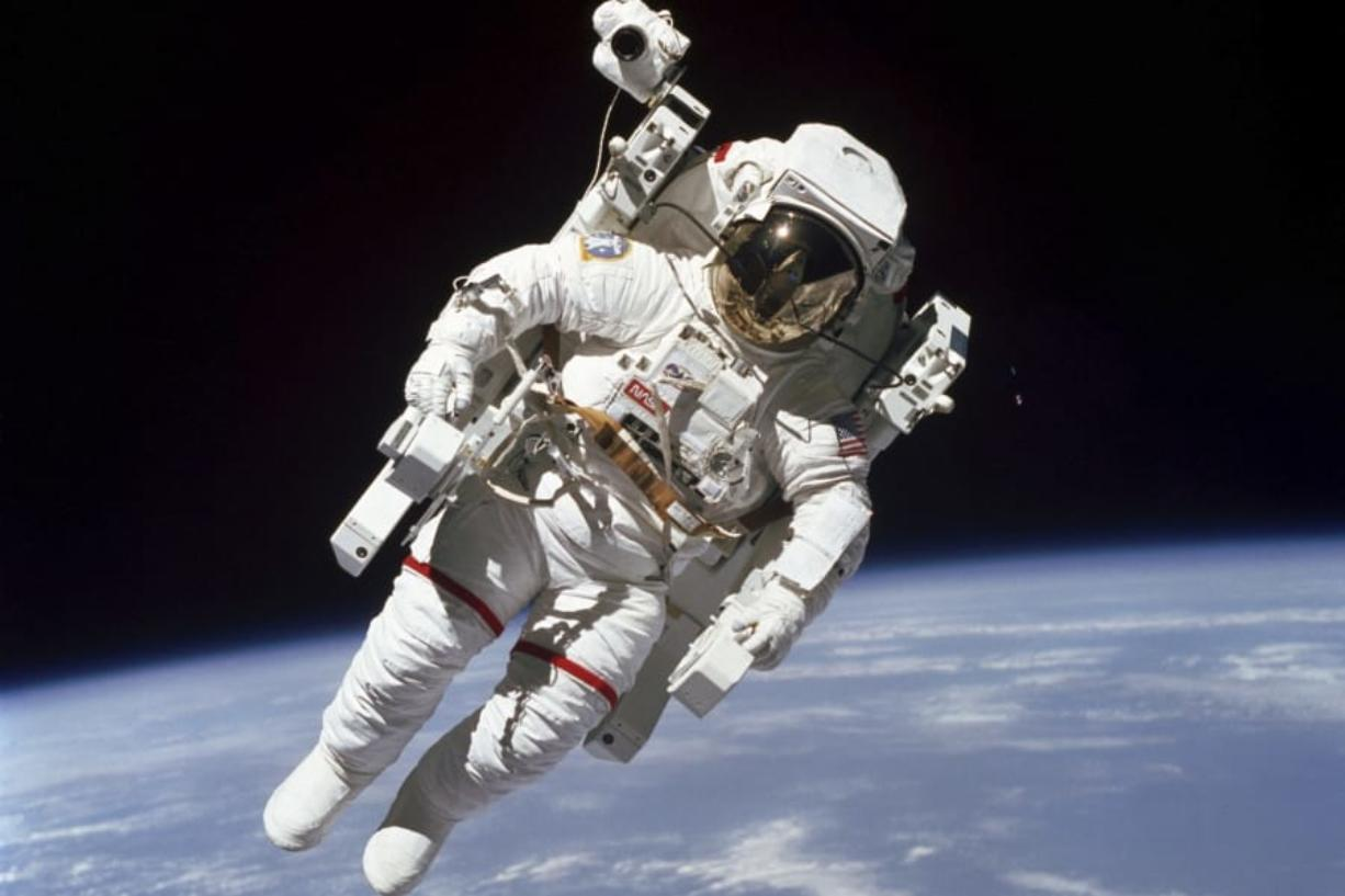 Astronaut Bruce McCandless II performs a spacewalk Feb. 7, 1984, a few meters away from the cabin of the Earth-orbiting space shuttle Challenger. More than 12,000 people applied for NASA's next astronaut class.