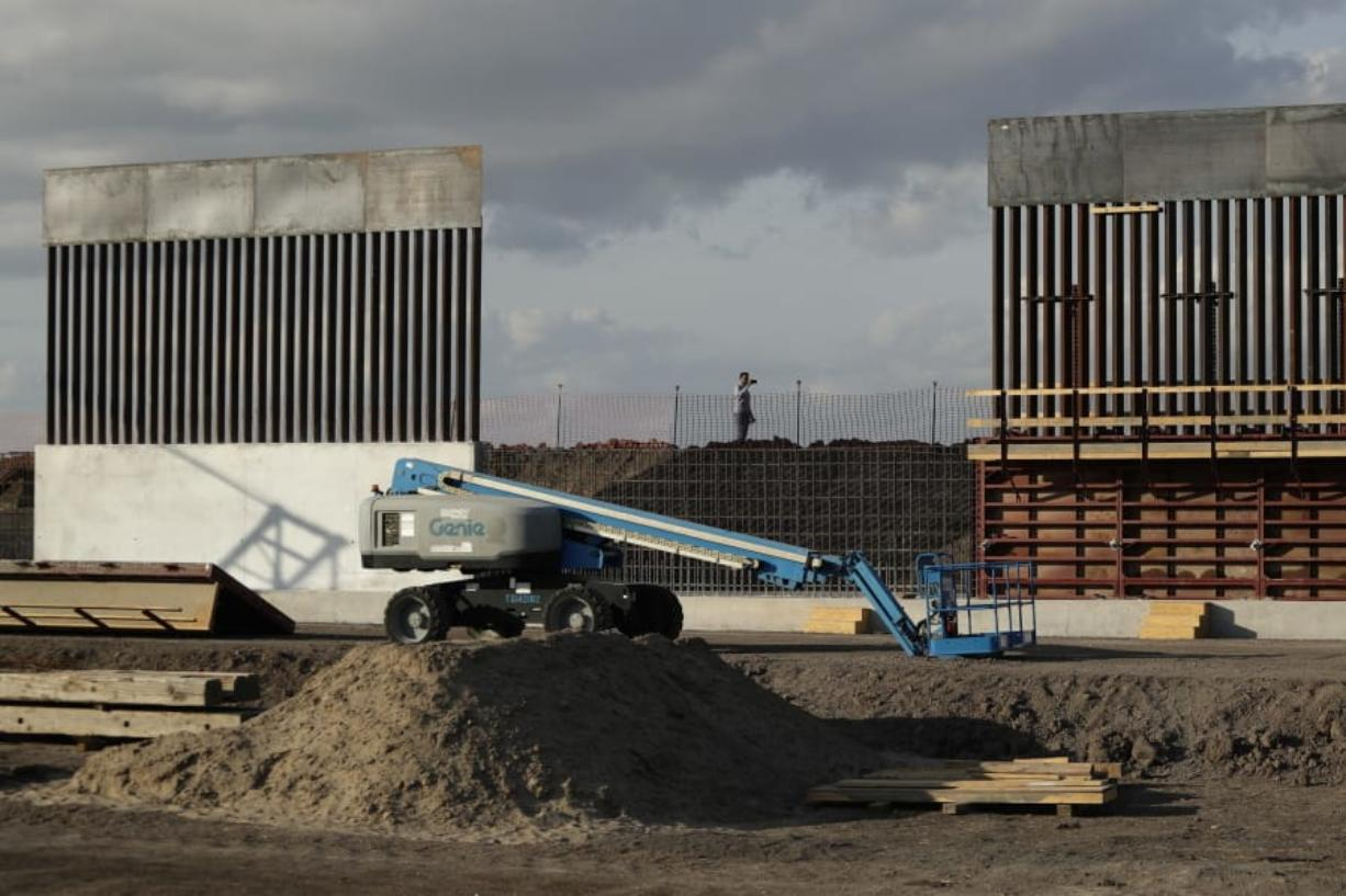 FILE - In this Nov. 7, 2019, file photo, the first panels of levee border wall are seen at a construction site along the U.S.-Mexico border, in Donna, Texas. Major construction projects moving forward along the U.S. borders with Canada and Mexico amid the coronavirus pandemic are raising fears workers could spread the sickness within nearby communities.