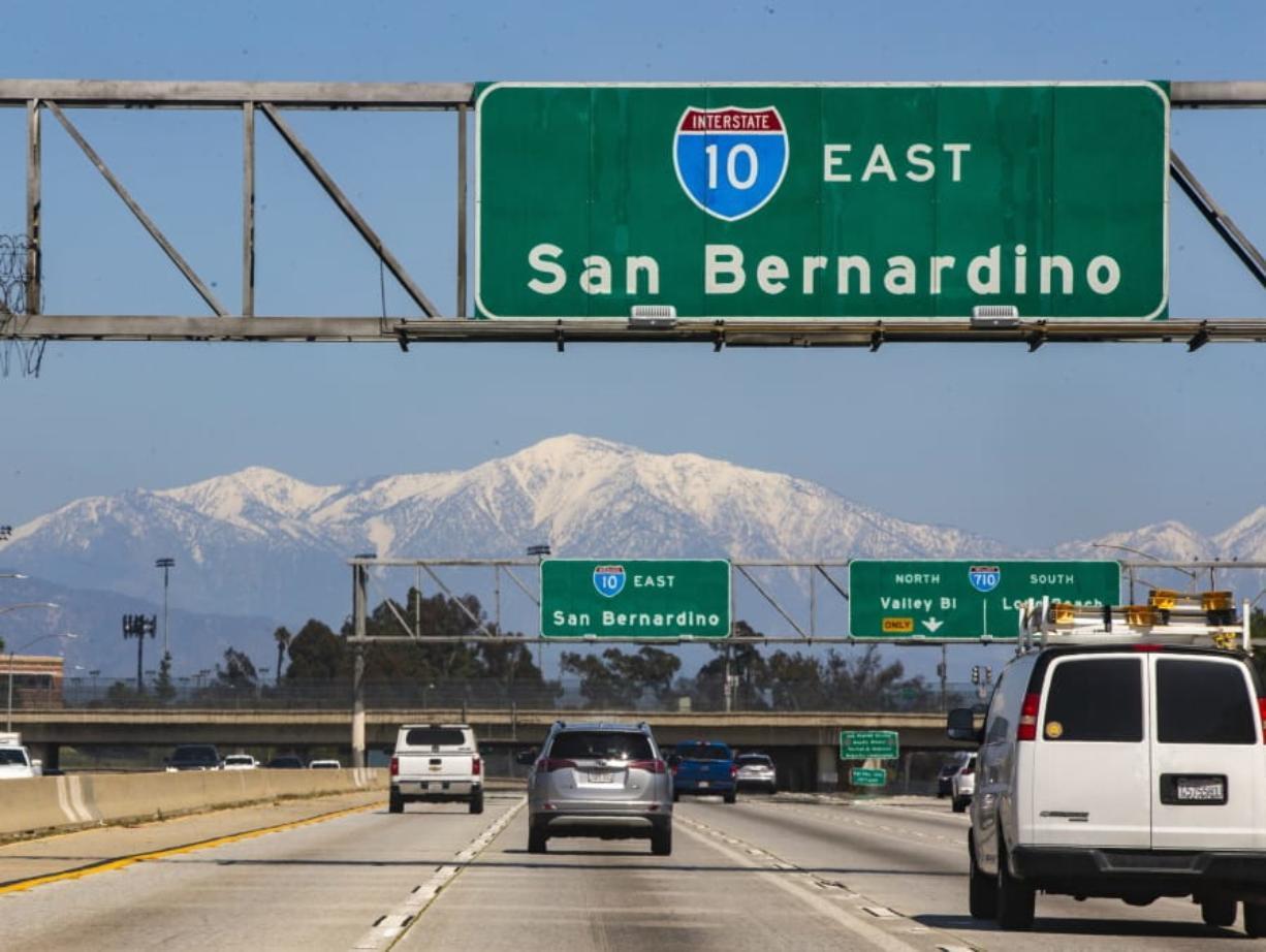 The San Gabriel Mountains are visible from Interstate 10 on March 30 in East Los Angeles. Improved air quality has resulted from business closures and recent rain in the area.
