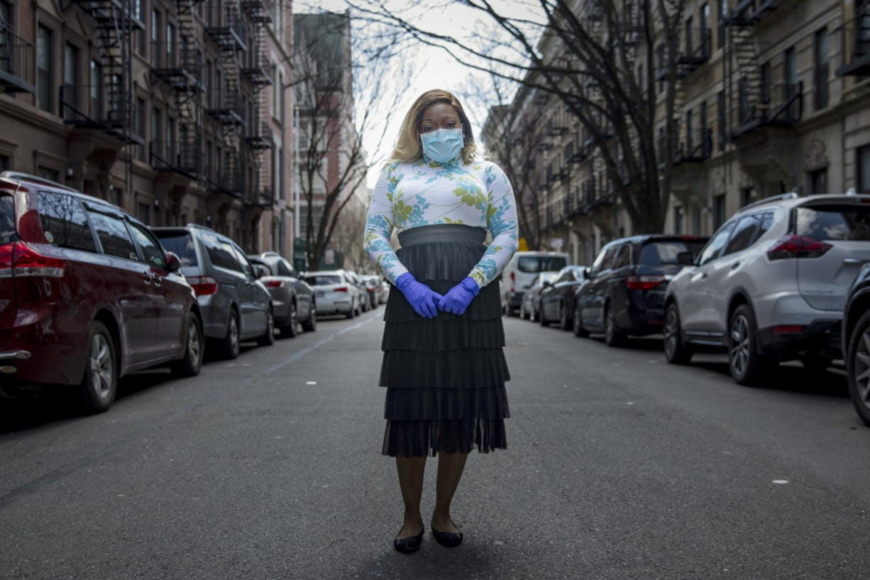 """Tiffany Pinckney poses for a portrait in the Harlem neighborhood of New York on April 1, 2020. After a period of quarantine at home separated from her children, she has recovered from COVID-19. Pinckney became one of the nations first donors of """"convalescent plasma."""" Doctors around the world are dusting off a century-old treatment for infections: Infusions of blood plasma teeming with immune molecules that helped survivors beat the new coronavirus."""