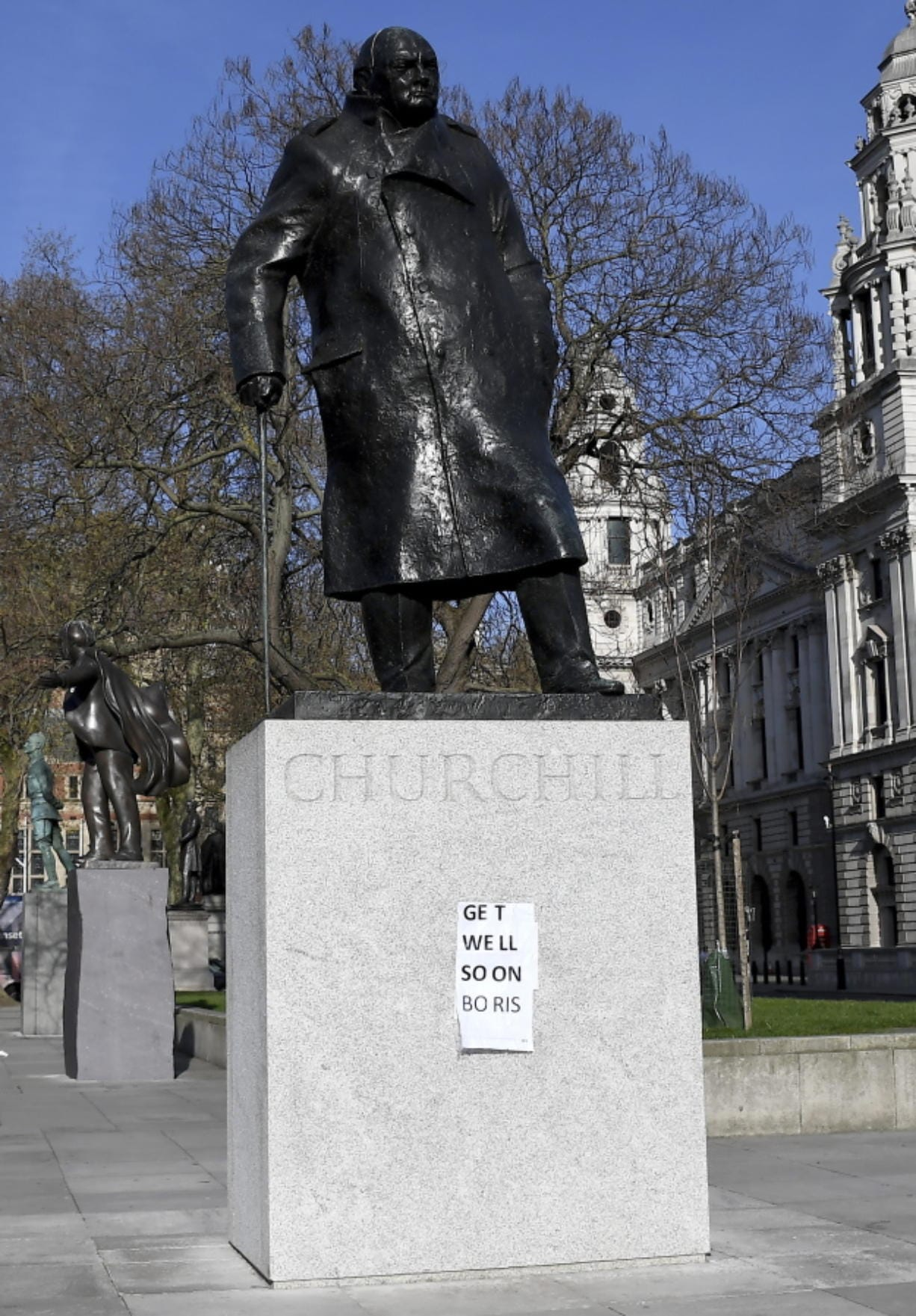 People have put a paper saying 'Get Well Soon Boris' on the statue of Winston Churchill in central London as British Prime Minister Boris Johnson was moved to intensive care after his coronavirus symptoms worsened in London, Tuesday, April 7, 2020. Johnson was admitted to St Thomas' hospital in central London on Sunday after his coronavirus symptoms persisted for 10 days. Having been in hospital for tests and observation, his doctors advised that he be admitted to intensive care on Monday evening.