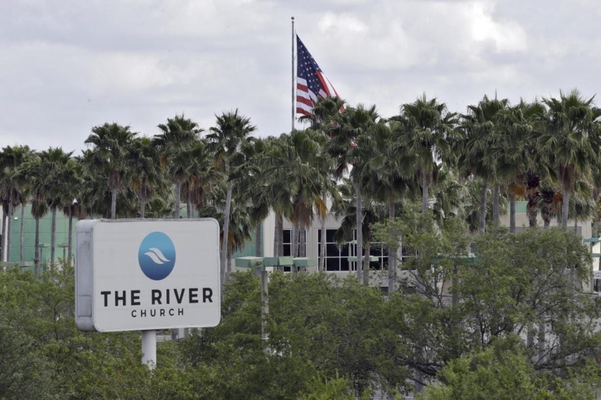 FILE - This Monday, March 30, 2020 file photo shows The River Church in Tampa, Fla. Pastor Rodney Howard-Browne was arrested Monday, March 30, 2020, for violating a county order by hosting a large number of congregants at the church.