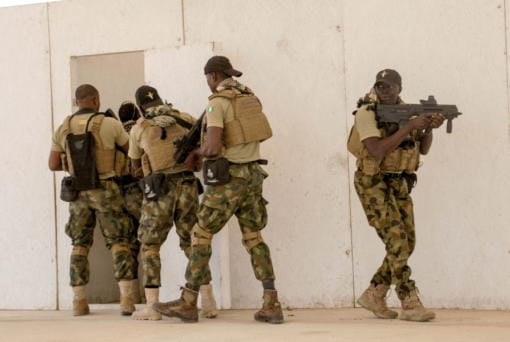 FILE - In this Feb. 18, 2020, file photo, Nigerian Navy Special Boat Service troops exercise under the supervision of British special forces during U.S. military-led annual counterterrorism exercise in Thies, Senegal. Both the Islamic State group and al-Qaida see the global upheaval caused by the new coronavirus as a threat but also as an opportunity to strike harder than before, asserting that the virus is punishment for non-Muslims while also urging followers to repent and take care of themselves. (AP Photo/Cheikh A.T.