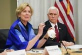 FILE - In this March 5, 2020, file photo, Dr. Deborah Birx, Ambassador and White House coronavirus response coordinator, holds a 3M N95 mask as Vice President Mike Pence visits 3M headquarters in Maplewood, Minn., in a meeting with 3M leaders and Minnesota Gov. Tim Walz to coordinate response to the COVID-19 virus. A review of federal purchasing contracts by The Associated Press shows federal agencies waited until mid-March to begin placing bulk orders of N95 respirator masks, mechanical ventilators and other equipment needed by front-line health care workers.