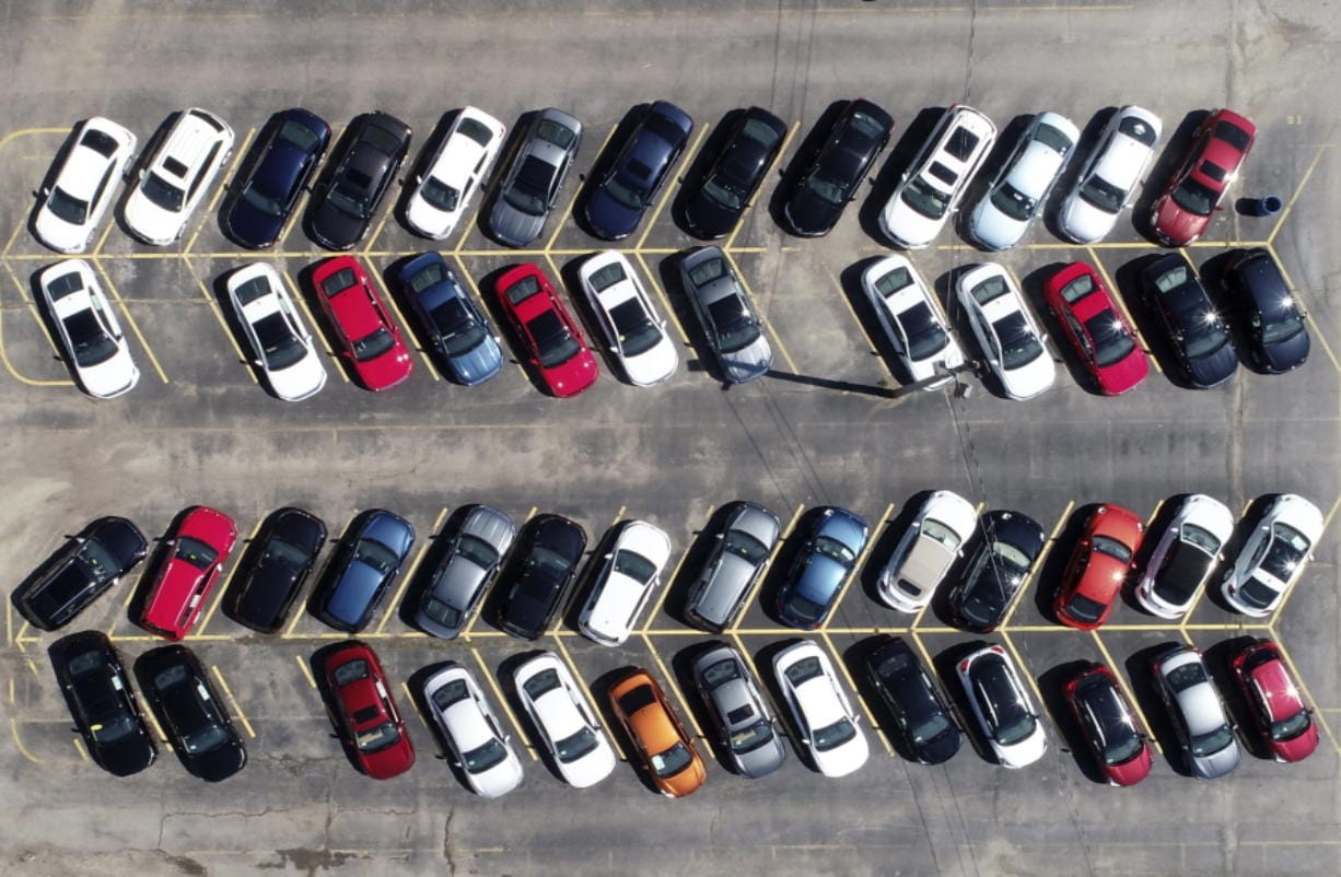 Cars are parked in an auto dealer lot Wednesday, April 15, 2020, in Green Park, Mo. U.S. retail sales recorded a record drop in March, with auto sales down 25.6%, as the coronavirus outbreak closed down thousands of stores and shoppers stayed home.