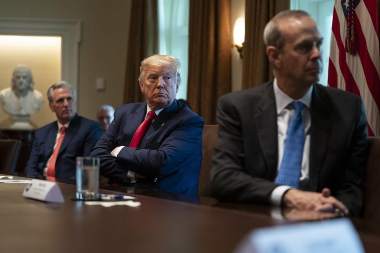 House Minority Leader Kevin McCarthy of Calif., President Donald Trump, and Chevron CEO Mike Wirth listen during a meeting with energy sector business leaders in the Cabinet Room of the White House, Friday, April 3, 2020, in Washington.