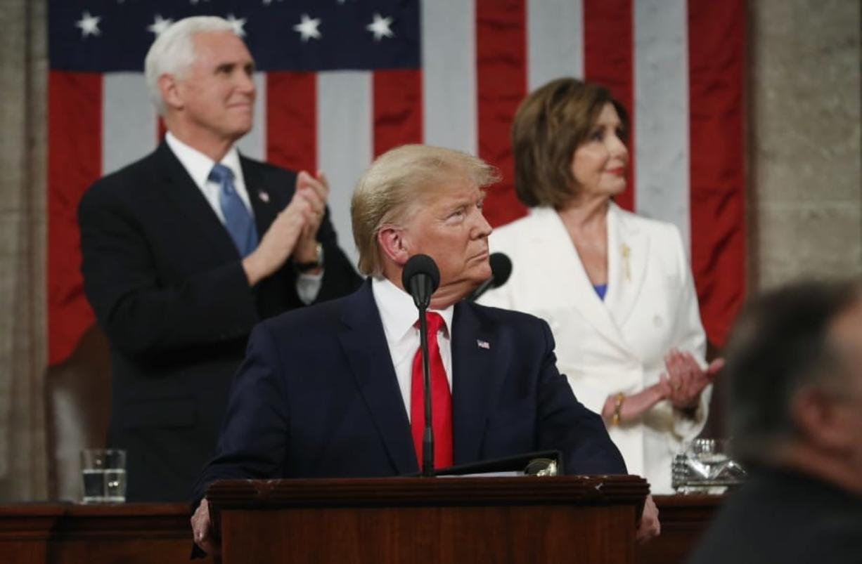 FILE - In this Feb. 4, 2020, file photo, President Donald Trump look to the first lady's box before delivering his State of the Union address to a joint session of Congress in the House Chamber on Capitol Hill in Washington,  as Vice President Mike Pence and Speaker Nancy Pelosi watch. Trump and Pelosi have not spoken in five months at a time when the nation is battling its worst health crisis in a century.