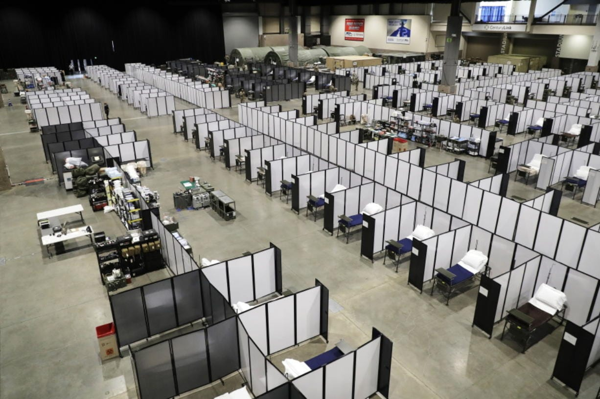Rows of patient beds are shown at a military field hospital, Sunday, April 5, 2020, at the CenturyLink Field Event Center in Seattle. Officials said the facility, which will be used for people with medical issues that are not related to the new coronavirus outbreak, has more than 200 beds and is ready now to receive patients. (AP Photo/Ted S.