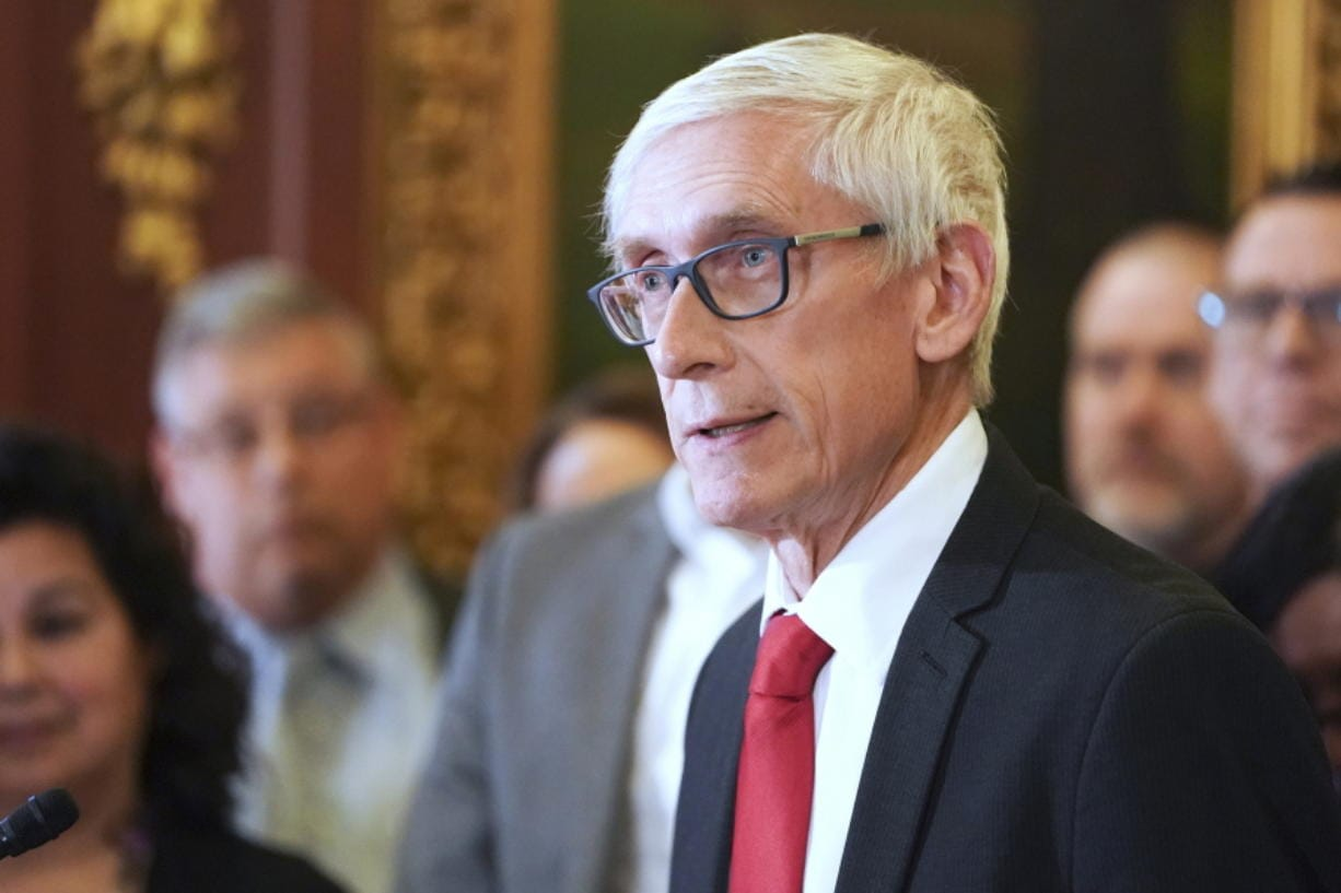 FILE - In this Feb. 6, 2020 file photo, Wisconsin Gov. Tony Evers holds a news conference in Madison, Wis. Wisconsin Democratic Gov. Tony Evers' administration is moving ahead with plans to buy 10,000 ventilators and 1 million protective masks in the fight against the coronavirus. The effort comes after Evers' administration had clashed with Republican lawmakers over whether he needed their permission to make such purchases.