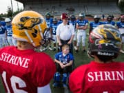 East All-Stars honorary captain Andrew Norton, 11, of Vancouver, is escorted by Shriner Bob Hitchcock, of Vancouver, for the coin toss before the start of the 2019 Freedom Bowl Classic at McKenzie Stadium. The 2020 game has been postponed until 2021 due to health concerns from the coronavirus pandemic.