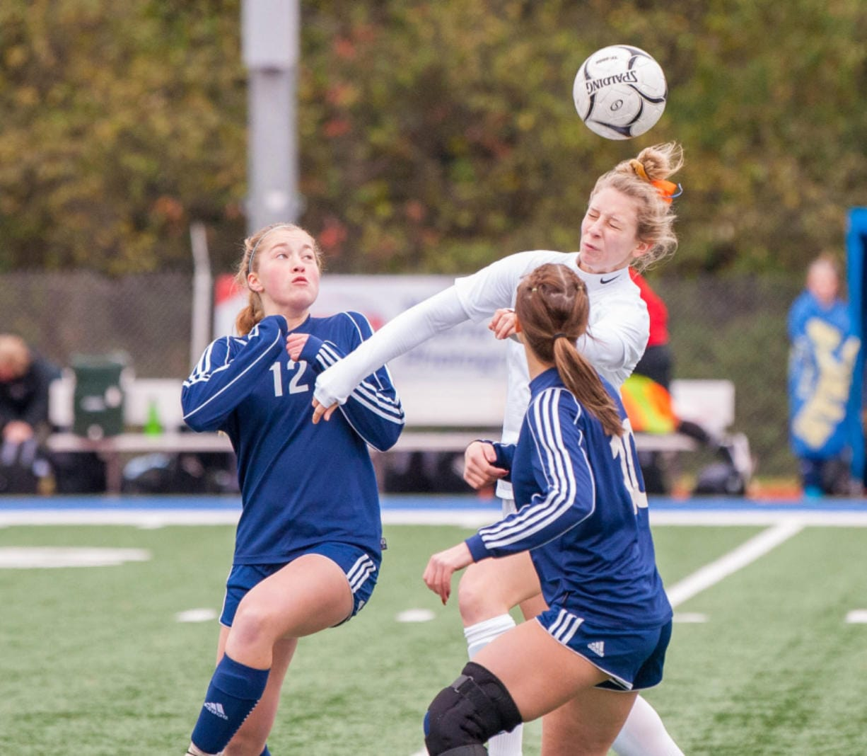 Ridgefield's Brooke Weese heads the ball over Selah defenders in the 2A third-place match last fall. The one-time Concordia commit will now play collegiate soccer at Humboldt State due to Concordia's closure in February.