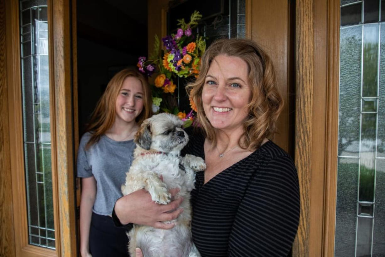 Caroline Hanna with daughter Jillian, 16, and their dog Benny at home in Mokena, Ill., on May 8. Hanna and her daughter tried to adopt an Australian shepherd puppy and sent $250 for a dog that didn't arrive.