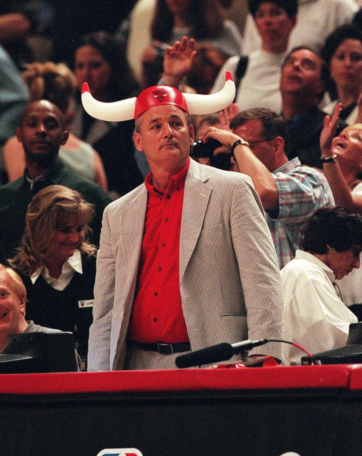 Bill Murray cheers for the Chicago Bulls as they play against the Indiana Pacers on May 31, 1998, at the United Center in Chicago.