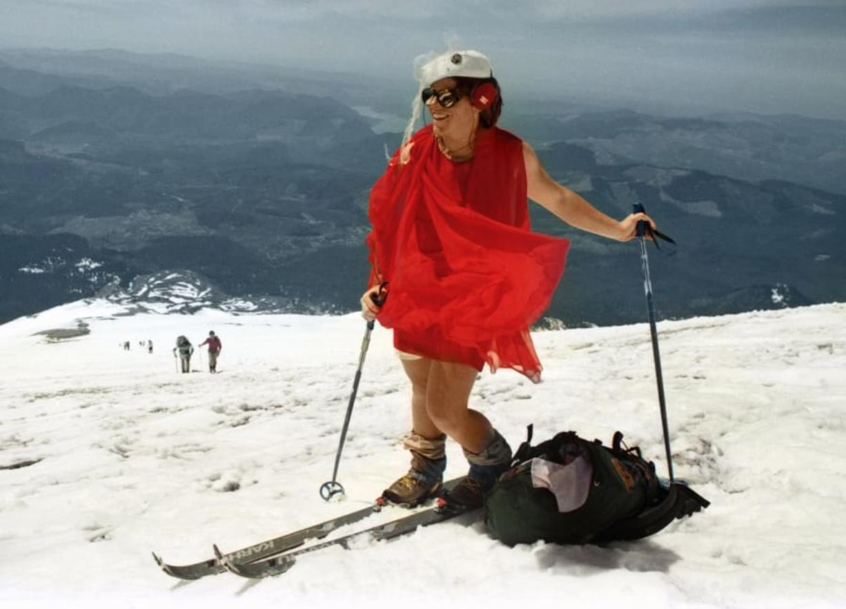 Kathy Phibbs climbed the Mount St. Helens wearing a red chiffon dress and a pillbox hat.