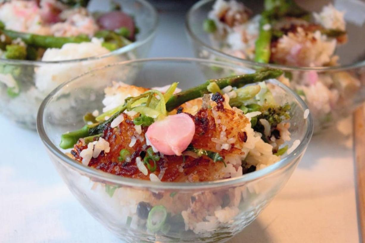 Crispy fried rice is made with leftover rice, frozen peas and window sill scallions, plus fresh spring asparagus and radishes.