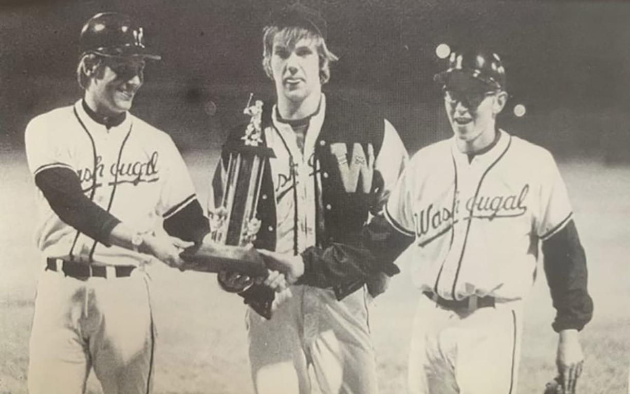 Washougal baseball coach Frank Jackson, left, and juniors Tim Wysaske and Russ Barber celebrate winning the 1973 Class A baseball state title in Wenatchee. The WIAA instituted a state baseball playoff system in 1973, and Washougal won three championships in six years.