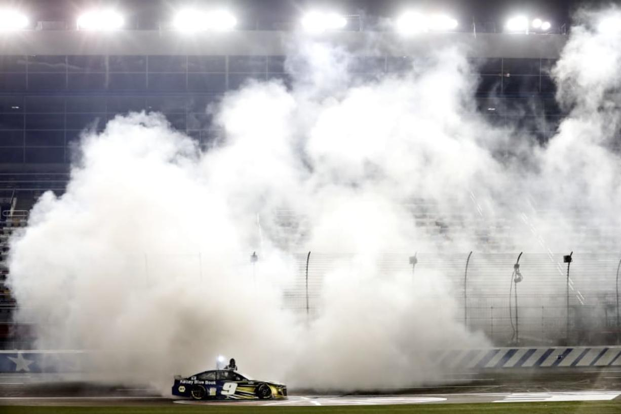 Chase Elliott does a burnout after winning the NASCAR Cup race Thursday at Charlotte Motor Speedway.