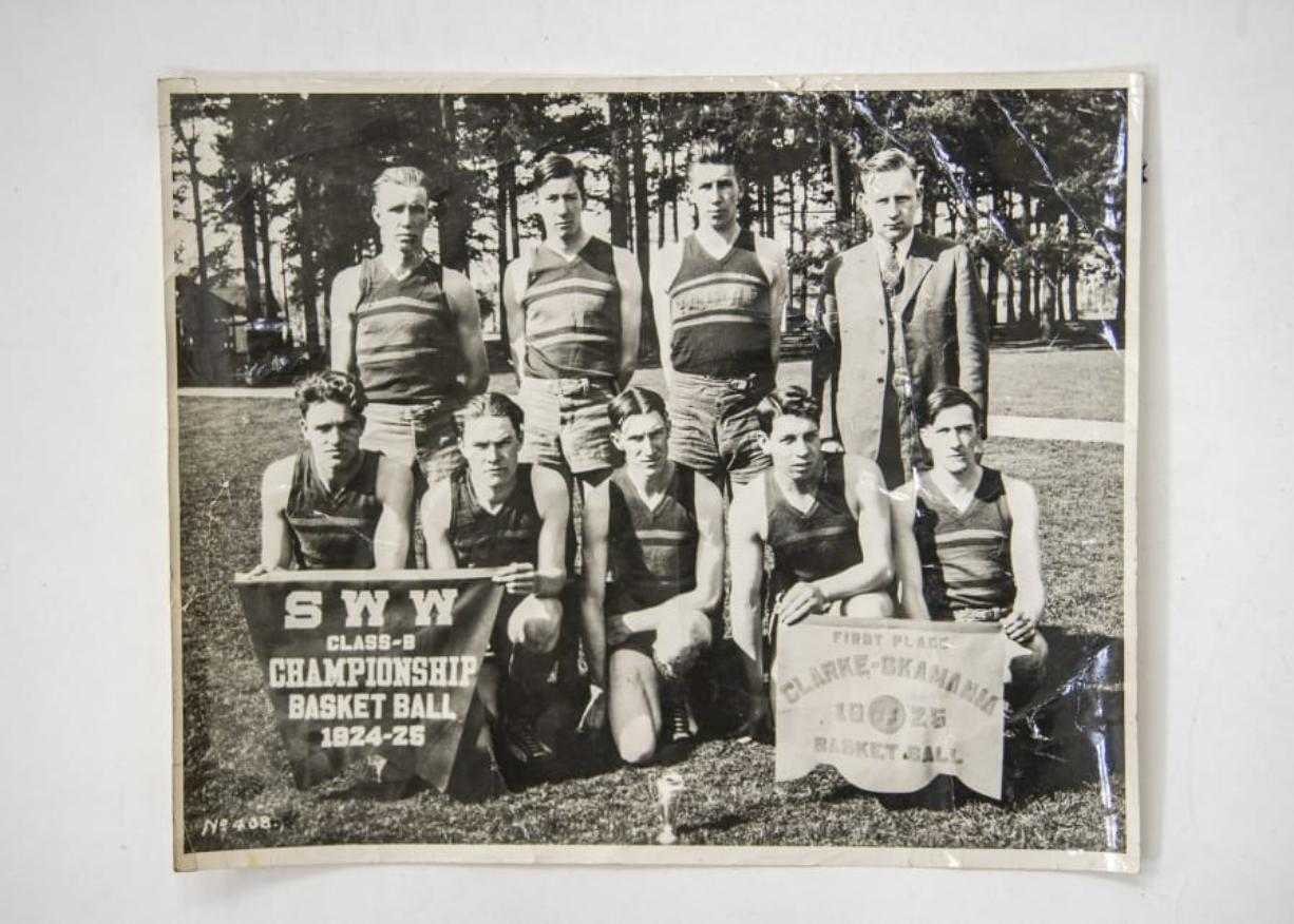 A photo, provided by Dorothy Brown, shows the Yacolt High School Loggers, which earned third place at the 1925 basketball state tournament at the University of Washington. Bottom row, from left: Marion Roper, Carl Olson, Clarence Grady, Charles Work, and Ernest White. Top row, from left: Rob Huffman, Charlie White, Fred Huffman, and coach Glen Hill.