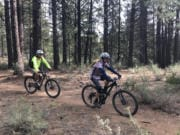 Mountain bikers ride the Catch and Release Trail southwest of Bend, Ore.