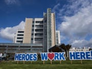 A sign outside PeaceHealth Southwest Medical Center honors hospital staff working hard to treat patients during the COVID-19 crisis.