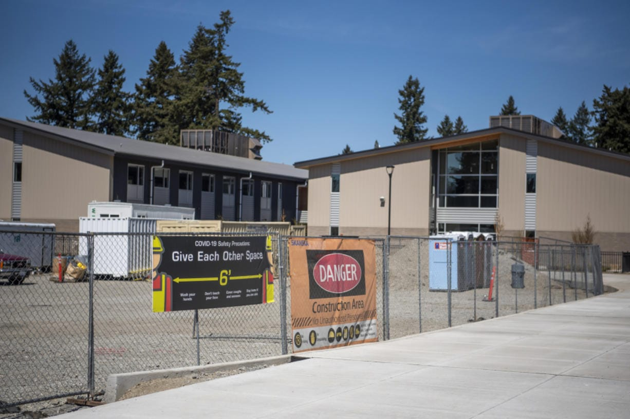 Construction continues at McLoughlin Middle School and George C. Marshall Elementary School in Vancouver, with precautions. More kinds of activities may soon be allowed on job sites.
