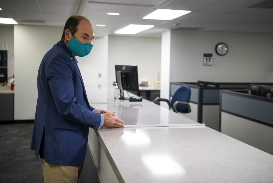 Clark County Auditor Greg Kimsey describes Friday the new glass screens that will be set up to help protect employees at the county elections office.