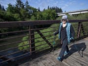 Peggy McCarthy enjoys the spring sunshine while walking the Salmon Creek Greenway Trail. Her plan to walk the Camino de Santiago pilgrim trail was blocked by COVID-19, but McCarthy sees every step she takes as part of her pilgrimage of gratitude.