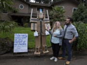 """Kaaren and Daniel Spanski-Dreffin of Vancouver look over their mannequin dressed up as Optimus """"Amazon"""" Prime in the front yard of their home Monday afternoon. The couple change his theme daily, to the delight of their neighbors. """"The whole idea is to make people laugh,"""" Daniel Spanski-Dreffin said."""