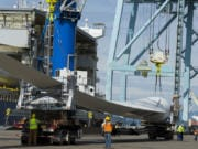 Workers unload wind blades bound for Canada from the MV Star Kilimanjaro at the Port of Vancouver on Monday morning. The ship departed China on April 13 and held 27 blades for nine wind turbines.