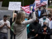 State Rep. Vicki Kraft, R-Vancouver, speaks to a crowd gathered in front of Clark County Courthouse to protest Washington Governor Jay Inslee's extension of coronavirus stay-at-home order in Vancouver on Friday.