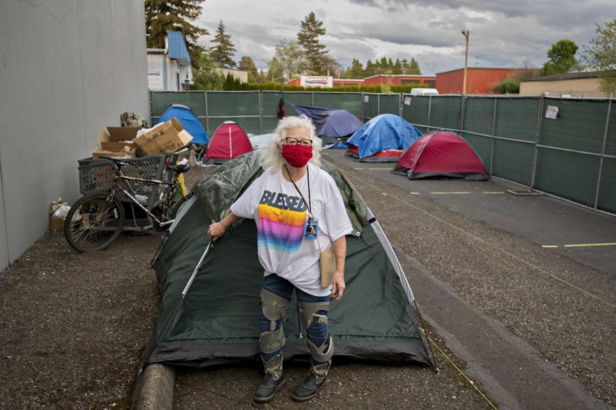 Linda Karschney volunteers Tuesday evening at the temporary homeless encampment outside Living Hope Church. Karschney is among several helpers from the congregation providing shelter, showers, snacks and restrooms to people without homes during the COVID-19 pandemic.