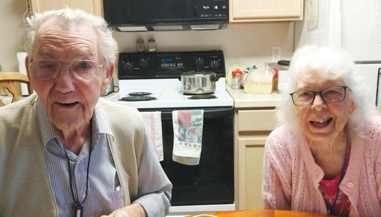 Lyle and Alice Leach, who just celebrated their 72nd anniversary, share a laugh at home.