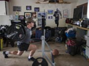 Mountain View's Riley McCarthy powers through his at-home training regimen in his family's garage Monday afternoon, May 11, 2020.